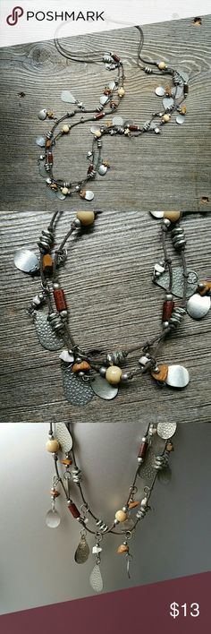 Adorable Multi Charm, Double Strand Necklace This cutie measures 34 inches long, and has a 17 inch drop.  Various charms on a dark brown string with clasp.  Bundle with another piece to save on shipping! Jewelry Necklaces