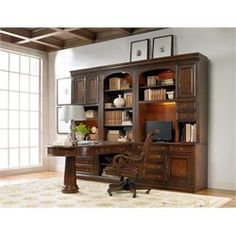 Ashley Danimore Oval Butterfly Dining Table In Light Brown