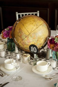 colorful vintage globes as centerpiece at Terminal City Club, Vancouver, B.C. with photos by Stone Photo | via junebugweddings.com