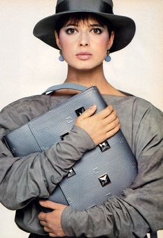 Bill King: Isabella Rossellini for American Vogue, March 1982. Case by Fendi, clothing by Norma Kamali.
