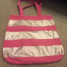 Loft pink and gold canvas tote bag Gently used (worn spots shown in pictures) pink with 3 gold stripes tote bag from Ann Taylor Loft. 14 inches across and 14.5 inches tall. Doesn't have a tag that says LOFT in it but I know I purchased it there! LOFT Bags Totes