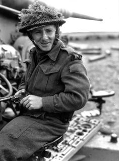 Member of North Shore Regiment, Brigade, Cdn Inf. Division poses on a Flak. Corporal McAllister (of Hamilton, Ontario) who was credited with the capture of 160 Germans around Saint-Lambert-sur-Dives poses on a captured gun. Canadian Soldiers, Canadian Army, Canadian History, British Army, History Online, North Shore, Military History, World War Two, Ottawa