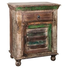 Feeling rustic this fall?  Awash in a distressed finish, this reclaimed mango wood end table showcases 1 drawer and a louvered door that opens to interior shelving.  ...