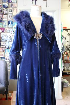 Phryne wears this beautiful blue velvet coat in 'Framed For Murder' (Series 2, Episode 9), The buckle is an original enamel buckle owned by the designer and purchased from an antique store.