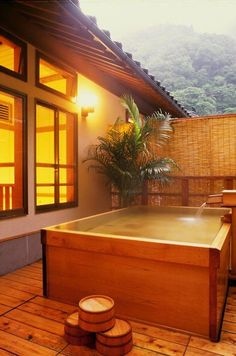 Encased wooden Japanese hot tub...for outside the perfect tiny home. Would be great in a HOT environment but you'd need a pump or chemicals for circulation against bacteria.