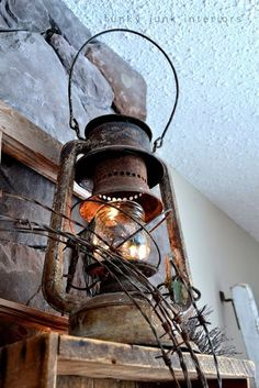 Old rusty lantern lit / part of How to decorate a junk style mantel via http://www.funkyjunkinteriors.net