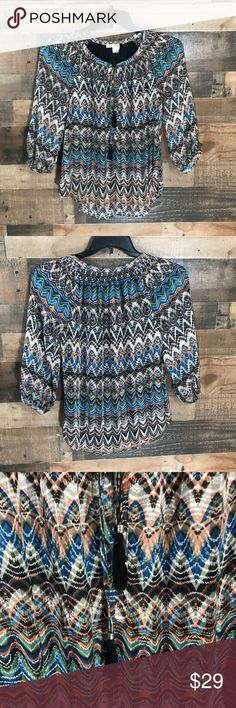 """Anthropologie Meadow Rue 3/4 Sleeves Blouse sz XS Anthropologie Meadow Rue Blouse. Size XS. EUC - no stains, signs of wear, or rips. Looks like a chevron print with more designs going on. Has tassels in the front. 3/4 sleeves.  Length- approximately 26.5""""  From armpit to armpit- 16.5"""" Bundle to save!! 💜 Anthropologie Tops Blouses"""