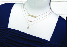 How to layer necklace with a square neckline.