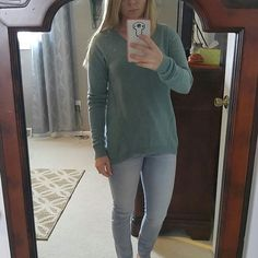 The Limited hi/low sweater. Beautiful sweater in green color. Hi/low so it is longer in the back! Perfect for leggings. The Limited Sweaters