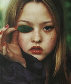 Beauty - behind the eye of the leaf holder? Model: Devon Aoki