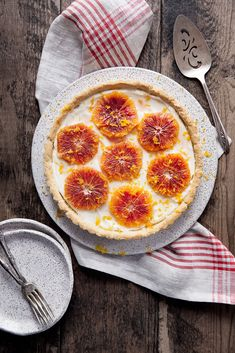 A flakey tart with cream cheese filling and topped with candied ginger blood oranges