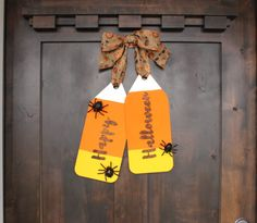 """Make a Halloween Door Tag Wreath that looks like candy corn. Use our kit with script wood letters """"Happy Halloween"""" and large wooden door tags. Halloween Door, Halloween Signs, Halloween Crafts, Happy Halloween, Halloween 2016, Autumn Crafts, Thanksgiving Crafts, Diy Letters, Wood Letters"""