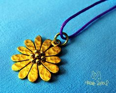 Necklace silver gold washed daisy with purple cotton thread.
