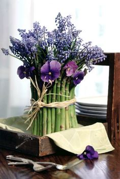 Wrap an arrangement of flowers in a grouping of asparagus to create a seriously creative flower arrangement.