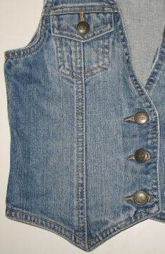 Love this Gap Kids denim blue jean vest with its classic jean-jacket styling, factory fading and distressed, whether intentional or not. It could be dressed up in any style from trucker to hipster! This item has been sold but be sure to check out the rest of the denim items in my eBay store by clicking on the picture. #gapkids #jean #vests