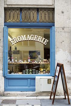 Fromagerie | Lyon, France. The leaded window, the beautiful French blue, the hand-painted window lettering, lovely! You know it's wonderful when the outside of the shop is as enticing as the promise of the bounty of cheese inside!