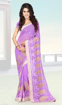 Be an absolute royalty of splendor in this lavender color chiffon embroidered sari. Beautified with crystals, lace, resham and stones all synchronized properly with the trend and style and design of the saree. Upon request we can make round front/back neck and short 6 inches sleeves regular saree blouse also. #LavenderEmbroideredSaree