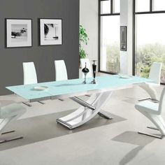 Chanelle glass rectangular extendable dining table in white with chrome legs, ultra modern piece will add elegance to dining room - 29445 shop online for dining tables at furniture in fashion. We have an extensive range of glass,. Glass Dining Table Rectangular, White Glass Dining Table, Extendable Glass Dining Table, Dining Table Design, Wooden Dining Tables, Modern Dining Table, A Table, Dinning Table, Dining Chairs