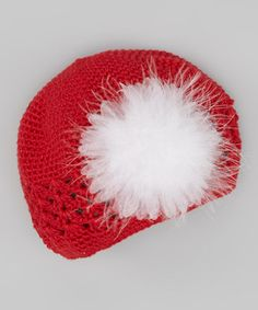 A festive marabou flower blossoms with cheery spirit on this snug beanie, lighting faces up with warm delight.