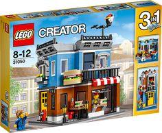 LEGO Creator 31050 Delikatesseforretning Åbn din egen delikatesseforretning med rød- og hvidstribet markise, farvestrålende facade og et sejt sandwichskilt. Lav sandwicher i det hyggelige køkken, og åbn så de store skodder og sælg dem til de sultne kunder, der haster forbi på fortovet med gadelamper og brandhane. Når det bliver tid til en pause, kan du tage trappen op til den hyggelige lejlighed på første sal med magelig lænestol, lampe og udgang til balkon og tagterrasse. Sættet kan bygges…