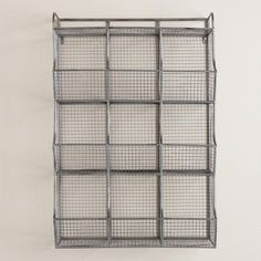 Made of galvanized metal with nine storage cubbies, our industrial-style wall unit is ideal for organizing a variety of supplies and essentials in one compact space. >> #WorldMarket Storage and Organization