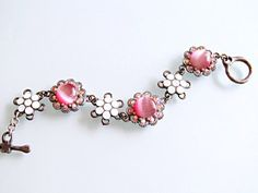 $48  Stunning bracelet with Swarovski White Opal and Rose AB crystals and pink can't eyes. Romantic and lovely!