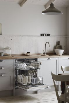 An integrated dishwasher is practical, handy and easily concealed. Shown here in our Allendale Dove Grey Shaker Style kitchen. Contact your local Howdens depot for more information. Grey Shaker Kitchen, Shaker Kitchen Cabinets, Kitchen Island Table, Shaker Style Kitchens, Narrow Kitchen, Kitchen On A Budget, Diy Kitchen, Kitchen Ideas, Open Cabinets