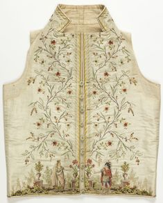 "Waistcoat, 1785–95 - ""White silk waistcoat with high stand collar and straight hem edge. Very deep border at front edges of a curving, flowering vine. At the bottom, embroidered figures in classical dress stand in front of a stone balustrade with urns of flowers and fruit trees. The figures represent Dido and Aeneas, from the opera by Piccini and Marmontel, produced in 1785."""