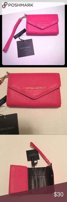 NWT Cynthia Rowley pink wallet phone case wristlet Brand new with tags, super cute pink. Thanks for checking out my closet. Cynthia Rowley Bags Wallets