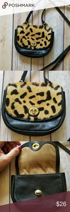"COACH mini crossbody bag Small saddle bag style crossbody with animal hair leopard print flap. Turnlock closure. 25"" strap drop. Good condition. Some light staining on interior lining Coach Bags Mini Bags"