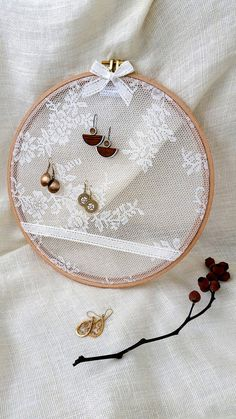Earrings rack , designed handmade from embroidery hoop , fabric and lace .  with perfect finish for easily hanging of all earrings Designed