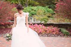 Vera Wang Bride's Laura wedding gown with asymmetrical neckline, fitted bodice and full tulle skirt. Photograph by Crystal Stokes Photography