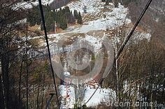 High mountains and snow, view between cable cars during winter.