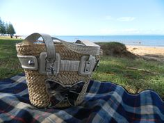 This is my current beach bag - a beautiful straw bucket bag with a big shiny butterfly on it. From Guess, of course.