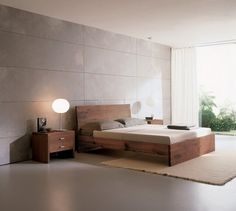 Modern Japanese Bedroom: simple bed design, clean textures and lines.