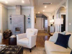Coastal living room with soapstone #Tulikivi wood stove.