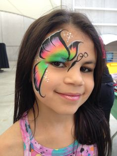 Neon butterfly face paint