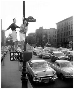 """""""The Skirt's the Thing,"""" Carmen Dell'Orefice and Betsy Pickering, First Avenue and 23rd Street, Harper's Bazaar, 1958. Photo William Helburn"""