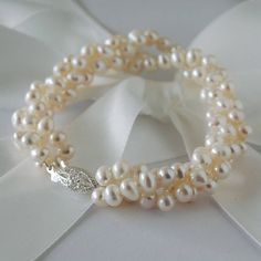 Multi Strand Pearl Bracelet by Highland Angel - 3 strand freshwater pearl bracelet with a delicate, vintage style sterling silver clasp./ Not on the High Street