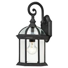 """Eco-friendly outdoor wall lantern.   Product: Outdoor wall lanternConstruction Material: Glass and metalColor: Black and clearFeatures: Will enhance any decorAccommodates: (1) 100 Watt A19 incandescent bulb - not included Dimensions: 15.75"""" H x 8"""" W x 7.88"""" D"""
