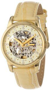 Stuhrling Original Women's 576.1135E15 Vogue Audrey Stella Automatic Skeleton Swarovski Crystal Gold Tone Watch Stuhrling Original. $164.00. Cream outer dial with Swarovski crystal markers and center skeleton cut out. Protective Krysterna crystal on front and back. Water-resistant to 50 M (165 feet). Polished 23k yellow gold layered round shaped case with knurl edge crown. Cream lizard embossed genuine leather strap with gold tone buckle. Save 75%!