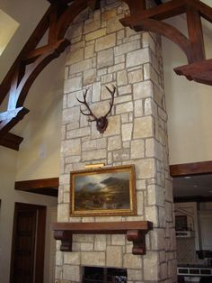 Highland Fling - Red stag antlers in the Legacy Panel, on fieldstone and with gorgeous beams.