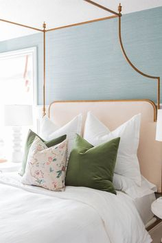 A 16-Color Spring-Inspired Whole-House Paint Palette | Love this girl's bedroom with the gold finish iron bed with a pink upholstered headboard, blue grasscloth wallpaper, pink accents. Think the green velvet pillows make the space. Design by House of Jade. Photo credit: Kate Osborne