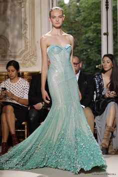 Lovely gowns from Georges Hobeika Fall/Winter couture collection. Sheer skirts that seem to float, delicate floral details, beribboned funnel necklines — this looks Couture Mode, Couture Fashion, Women's Fashion, Couture Dresses, Bridal Dresses, Fall Dresses, Georges Hobeika, Mermaid Gown, Designer Gowns
