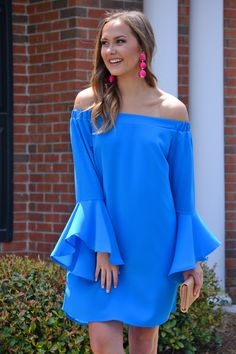 "Bright blue, an off shoulder fit aaaand bell-sleeves; yep we're in heaven. Complete the look with our ""Blogger Ball Earrings!"" Sleeves feature elastic for a comfortable fit that stays in place."