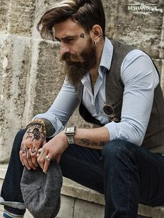 "I like the ""vest, shirt, jeans"" look, probably with some nice looking boots/shoes to finish it off."