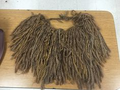Lawrence Jones Middle School- Lion King Jr Mufasa mane. Made with Lion Brand thick yarn