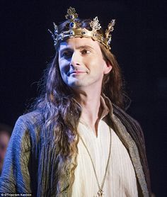 He's the king: The actor's long hair extensions fall across his shoulders