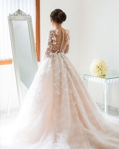 Beautiful ball gown wedding dress with sleeves. Gorgeous blush wedding dress. This sophisticated and seductive tied together with delicate lace patterns #weddingdress