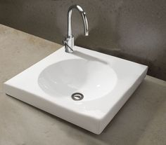 Kado Cirque Semi Inset Counter Basin - Characterised by lines as natural as the water that flows through them, the Kado basin collection continues an outstanding tradition of inspired design.